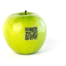 Image: Green apple with a QR Code sticker